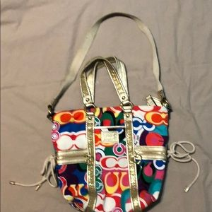 Multi colored Coach Poppy edition purse with gold